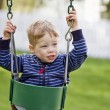 Nervous boy on swing — Stock Photo