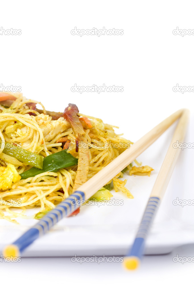 Vegetable and meat asian noodles on a plate with chopsticks — Stock Photo #8404813