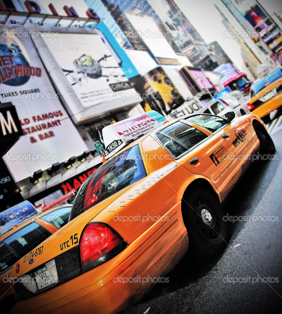 NEW YORK - DECEMBER 29: Yellow cab speeds through Times Square landmark during run up preparations for New Years Eve event on Dec 29, 2009 in New York, NY, USA.  Stock Photo #8408913