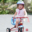 Foto Stock: Cute girl on bike