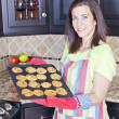 Woman baking cookies — Stock Photo