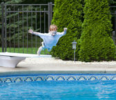 Boy jumping into pool — Stock Photo