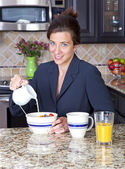 Businesswoman having breakfast — Stok fotoğraf