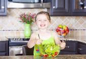 Girl making salad — Stock Photo