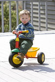 Boy on bike — Stock Photo