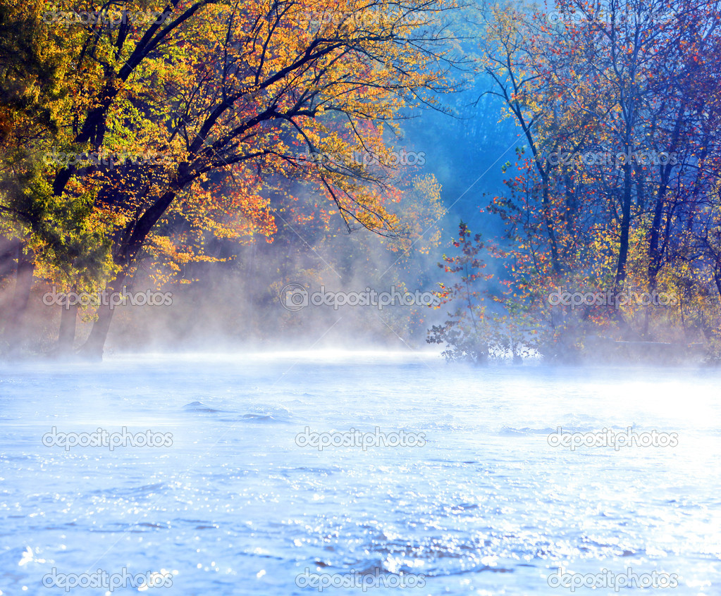 Beautiful scenic river in fall with early morning mist  Stock Photo #8421387