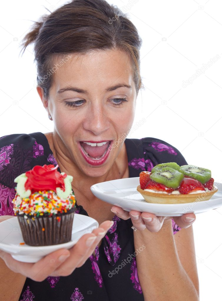 Atractive woman with two desserts in studio  Stock Photo #8421899