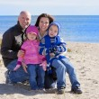 Family of four at the beach — Stock Photo #8866970