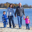 Stock Photo: Family of four at the beach