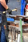 Farrier making a horseshoe — Stock Photo