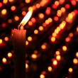 Light candles in a crypt - Stock Photo