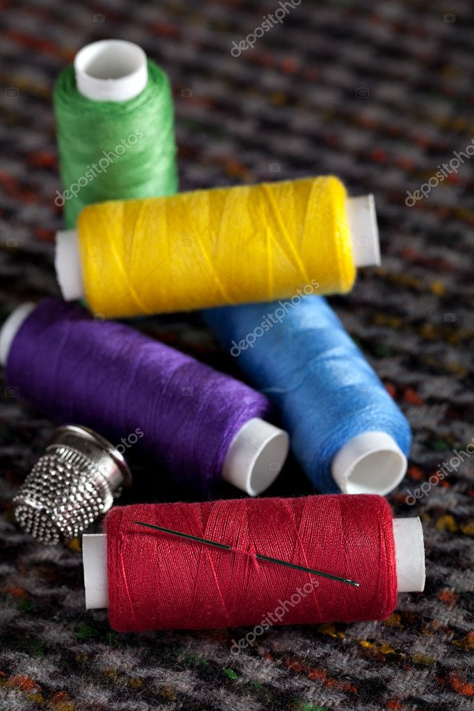 Pile of coloured bobbins of thread — Stock Photo #10662122