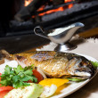 Fish dinner on a plate — Stock Photo