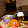 Food on wooden tray and beer — Stock Photo