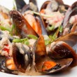 Bowl with cooked mussels - Stock Photo