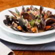 Bowl with cooked mussels — Stock Photo