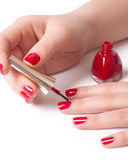Woman applying red nail polish — Stock Photo