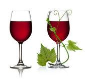 Glass of red wine with grape leaves — Stock Photo