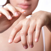 Cream on the women hand. — Stock Photo