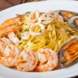 Fettuccine and seafood — Stock Photo