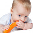 Baby with carrot — Stock fotografie #8956000
