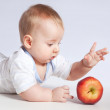 Small baby with apples — Stock fotografie #9094531