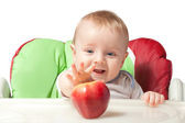 Small baby with apples — Stockfoto