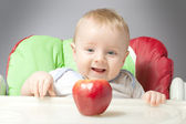 Small baby with apples — Stock Photo