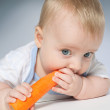 Baby with carrot — Stock Photo #9326253
