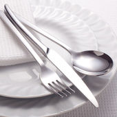 Fork, knife, spoon and a white plate — Stock Photo
