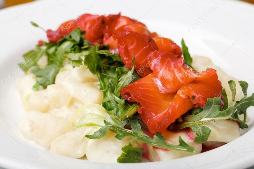 Pumpkin gnocchi with salmon — Stock Photo #9570419