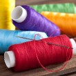 Coloured bobbins of thread — Stock Photo