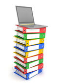 Laptop on Stack of Folders — Stock Photo