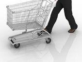 De man rolt lege winkelwagen — Stockfoto