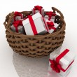 Gift boxes in a braiding basket — Stock Photo