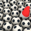 Soccer balls and santa claus red hat — Stock Photo