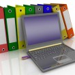 Colorful folders next to a modern laptop — Stock Photo