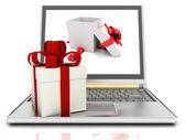 Laptop and gifts — Stock Photo