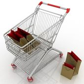 Shopping cart and shopping bags — Stock Photo