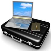 Silvery laptop and notepad with pen on black case — Stock Photo