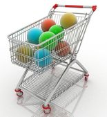 Shopping cart full with christmas balls — Stock Photo