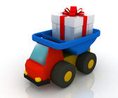 Toy truck drives a gift — Stock Photo