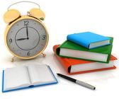 Alarm clock near stack of books — Stock Photo
