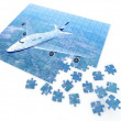 Royalty-Free Stock Photo: Puzzle with by flying airplane