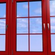 Sky seen through an red window — Stock Photo #8377090