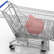 Stock Photo: Save money shopping concept with piggy bank in a shopping cart