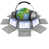 Globus in Headsets in den mittleren laptops — Stockfoto