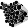 Set of pipes lying in one heap — Stock Photo