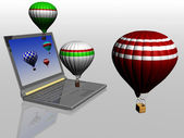 Hot air balloons take off from the screen of laptop — Stock Photo