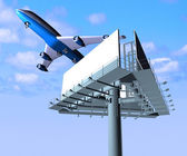 Airplane and billboard on a background sky — Стоковое фото